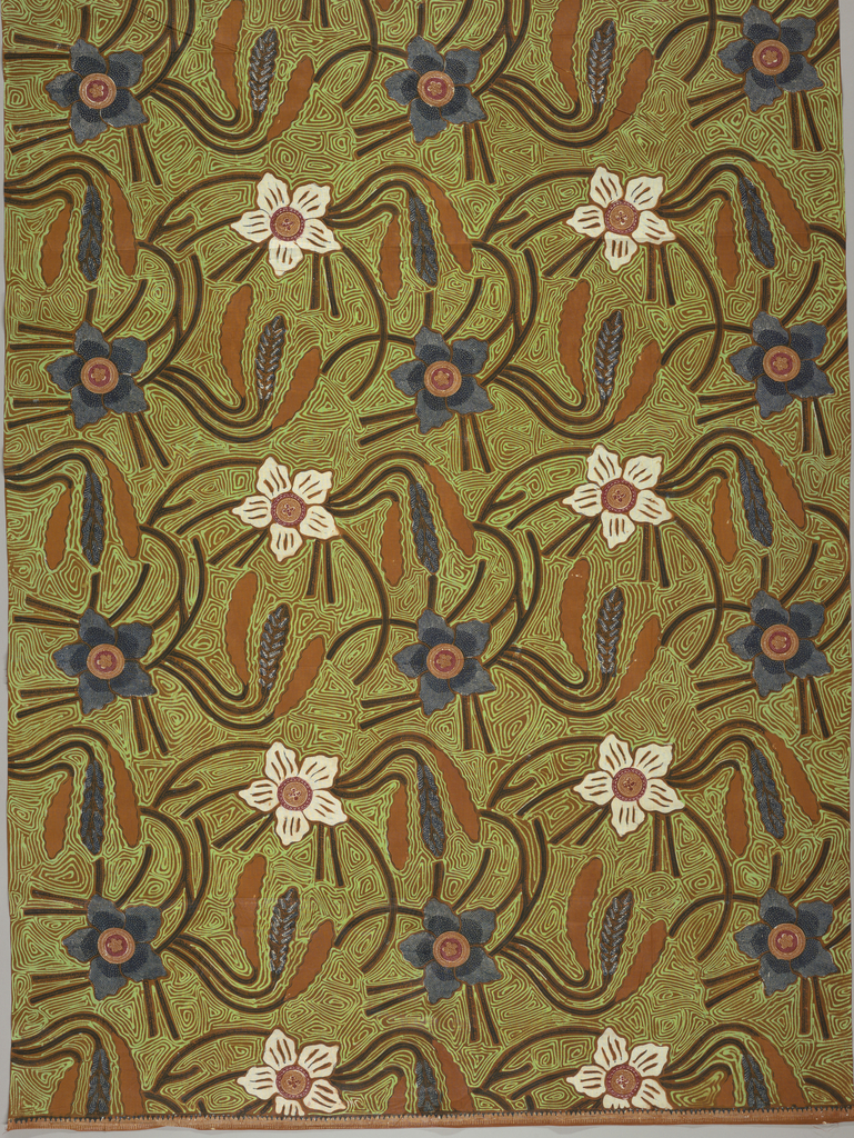 Textile, probably a sarong, with straight repeat of a white and blue-purple floral motif with branches and leaves, some of which are patterned with small, repeating dots and lines. All on a brown and bright green meander ground.