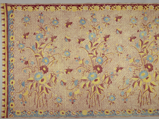 "Batik sarong in red, blue, yellow, and cream color. Shows an all-over ""banji"" motif (swastika variation) with butterflies around a large-scale floral pattern (""buketan"" motif), at intervals. Scalloped floral borders (a North Javanese batik innovation) within another border."