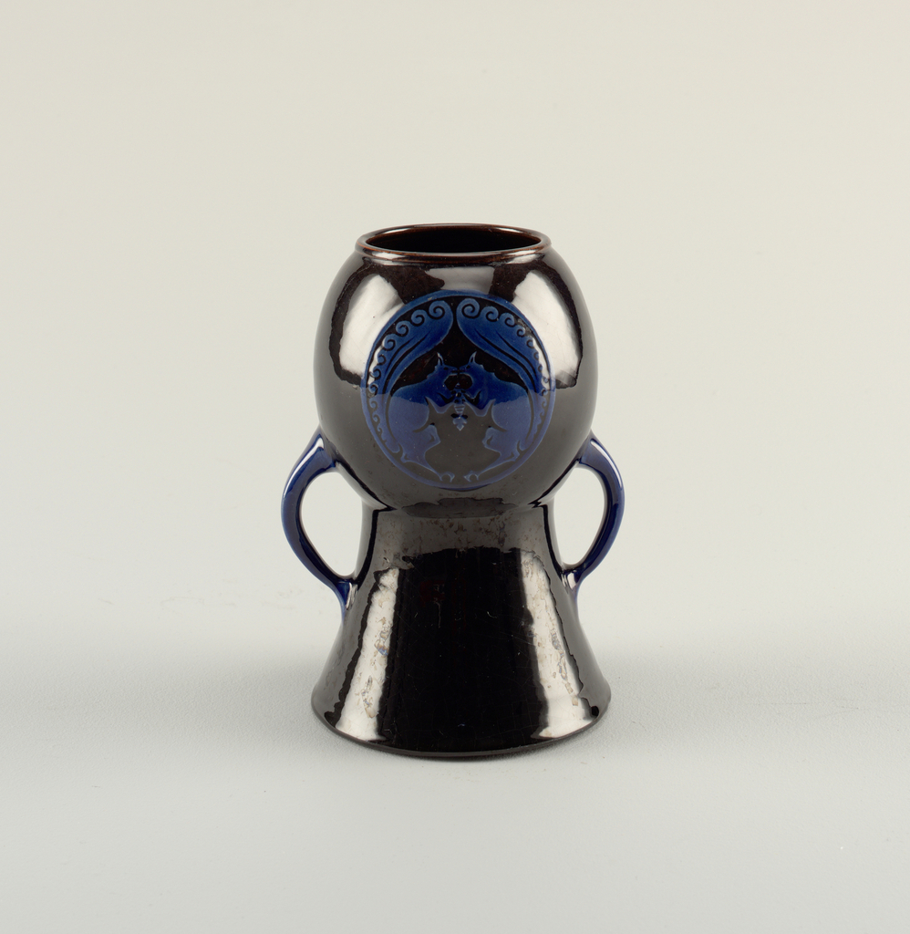 Two-handled vase with flare foot and bulbous top; on top decorated with two blue mirror images of squirrels in relief; framed by tails with curls, they both hold an acorn in their paws.