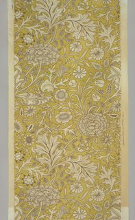 Large scale design filling the width of the textile with diagonally curving stems, curling leaves, and massive compound flower heads, with smaller flowers, thistles and leaves, in white with tan, and dark brown outlines on ochre ground. Wide plain selvedges with double warps.