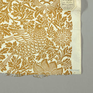 Medium-scaled design of flowering branches with perching birds. In deep golden yellow on a white ground, with plain unprinted selvedges.