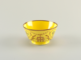 Footed bowl with copper luster decoration with foliage and square motifs on a yellow background; rim is copper luster.