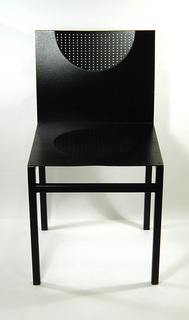 Angular chair made up of one metal sheet for back and one for the seat, each with curved indentations for body parts. Straight legs and cross bars.