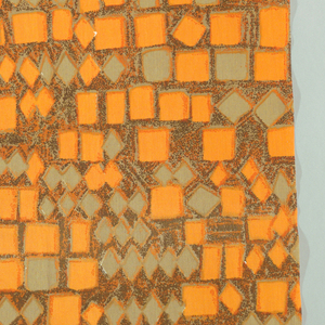 Irregular block design in strong orange and grey-green against mottled brown background. Small Liberty tag attached. Both selvedges present.