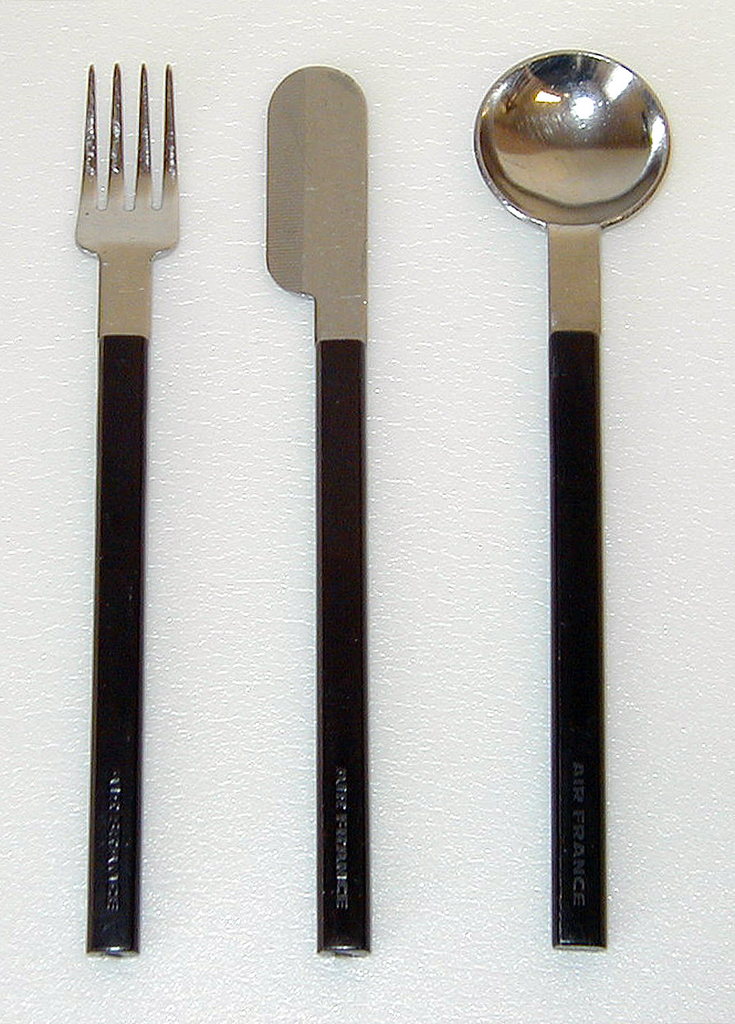Stainless steel tines and bowl. Four short tines, with squared shoulder. Molded brown plastic handle of rectangular section with rounded sides and blunt end.