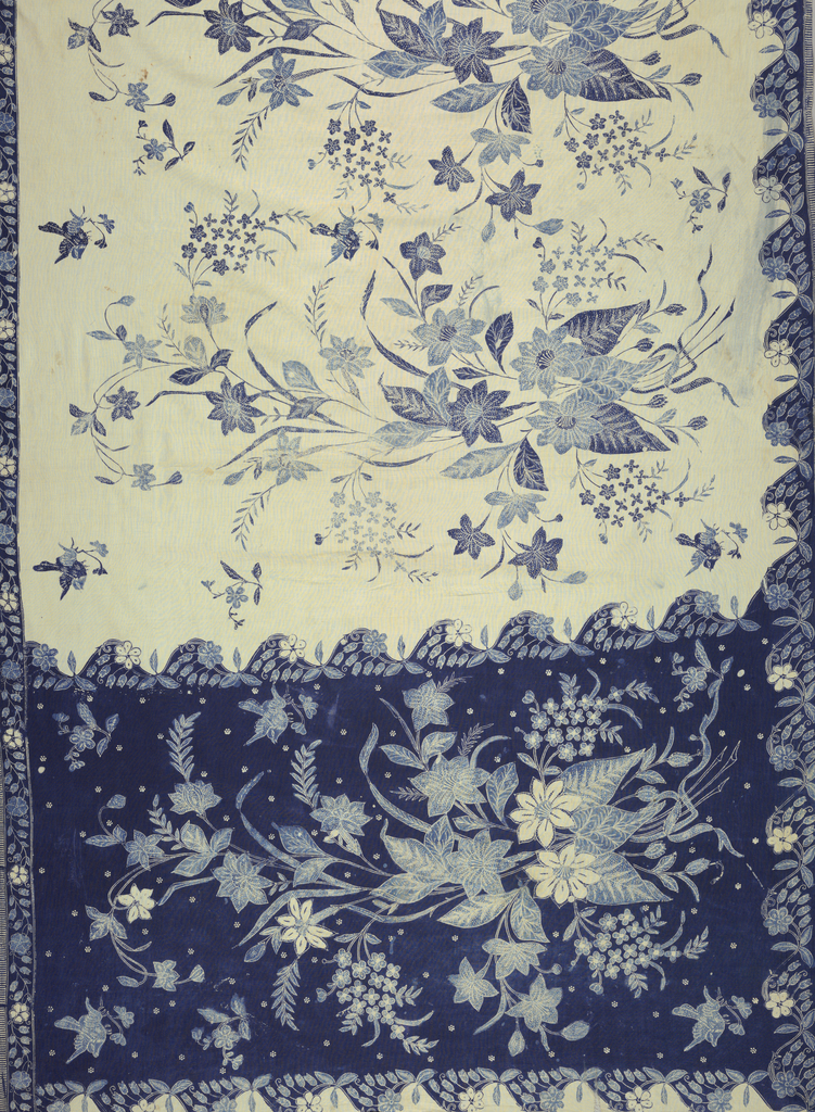 "Part of a sarong showing a white field with narrow blue borders on two sides and wide blue border at end. Borders display blue and white floral pattern and two of the borders are scalloped on the inner side (a North Javanese batik innovation). Ornamented with the ""buketan"" motif (large-scale pattern of floral bouquets and birds) reflecting foreign influence."