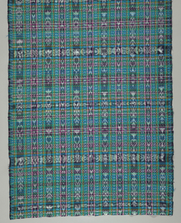 Woven length of warp and weft ikat (jaspeado) plaid in bands of pink, yellow, black, blue, and white on a green ground.
