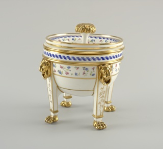 Semi-ovoid, cylindrical rim; four rectangular legs with lion mascarpone at knees, and paw feet. Lining a flattened hemisphere, with flaring rim and flat edge. Cover is concave, with textured bulbous handle and cylindrical edge. Decoration of scattered floral sprays and blue ribbons.