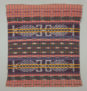 Plaid with narrow blue stripes on a red ground with wide bands of jaspe patterning in a geometric design. Two narrow yellow vertical stripes run through the largest areas of jaspe patterning.