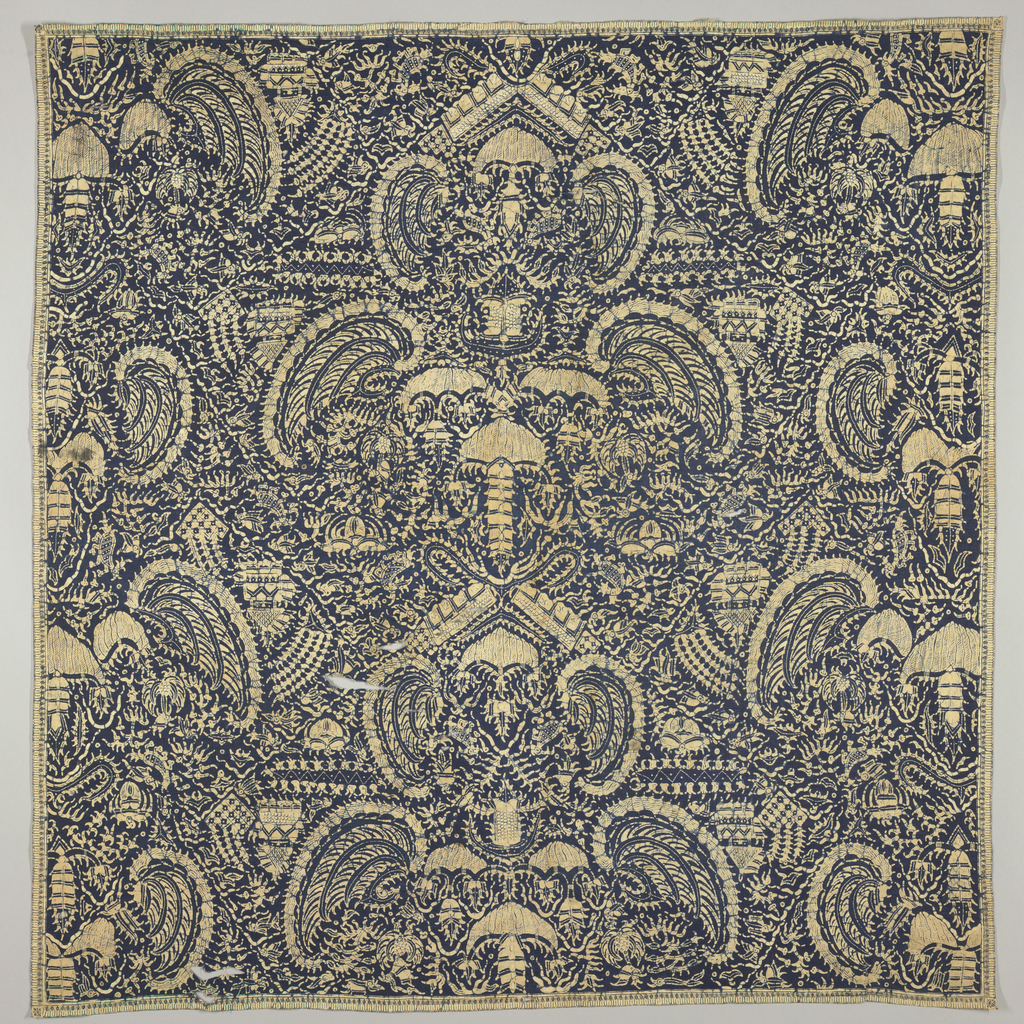 "Square textile (may be a head cloth or 'kain kepala') with symmetrical ""mirong"" motif (wings of Garuda, mount of Vishnu) on ground covered with crayfish, birds, etc. In beige with blue crackle on dark blue ground. Narrow border on four sides: plain cloth selvedges on two and the other two are handhemmed."