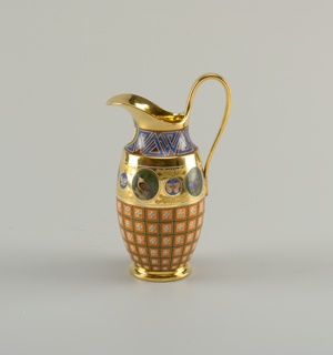 Vase-shaped jug with broad everted lip and tall loop handle. Decorated en suite with set: five large roundels with birds, four with butterflies. Lip, handle and foot gilded. Shell motif painted below lip.