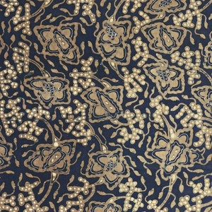 A long sarong (kain panjang) with a blue ground and design in brown and white. All-over floral motifs with vine or tendril design.