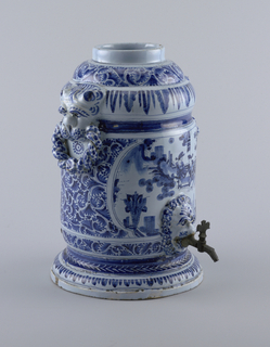 Molded cylindrical base and top; lion mascarons in relief; two at either side holding intertwined handles, one at bottom of front holding bronze tap. Shaped panels on front and back with Chinese figures in landscape; conventional foliage design on field and moldings. No cover.