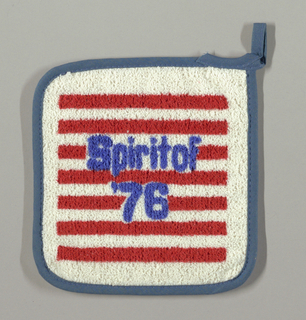 """Commemorative pot holder with alternating red and white striped background with """"Spirit of 76"""" in blue in the center. Blue bias tape is sewn to outer edges and is used to make a loop."""