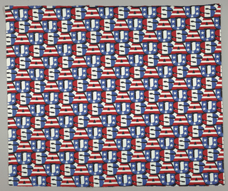 "Commemorative fabric with bold typeface showing horizontal and vertical repeats of ""USA."" The ""U"" is blue with white stars; the ""S"" has red, white and blue vertical stripes; and the ""A"" has horizontal red and white stripes. Typeface has a deep black shadow."