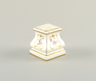 Quadrangular, with ogee sides on low square plinth. White, with gold linear decorations and four panels containing sprays of flowers in overglaze enamels.