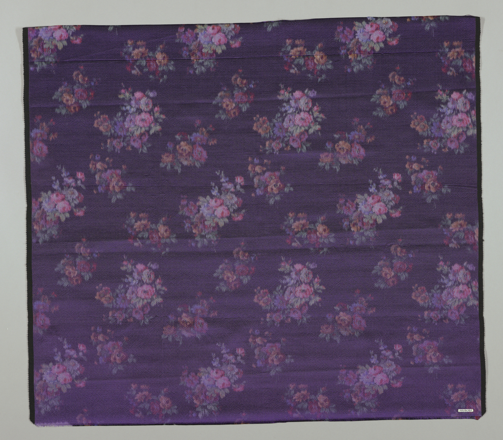 Heavyweight silk with horizontal ribbing has a multicolored design of small-scale sprays of roses and other flowers on a dark purple ground. Both selvedges present.