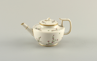 Circular teapot on plain foot with strait spout, squared strap handle, rounded bowl and flattened cavetto top. Flat domes cover with apple-shaped knob. Gilded edges with small sprays of pink and green flowers.