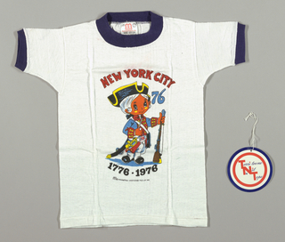"""White T-Shirt with Bicentennial dye transfer on front. The transfer is a child dressed in Revolutionairy War soldier costume with a '76 Belt Buckle. The child is holding a rifle in one hand and is wearing a saber on the belt. Under the soldier is 1776-1976. Under the 1776-1976 is """"Manhattan Post Card Pub. Co., Inc. To the upper right of the soldier are the numbers 76 and above the soldier is """"New York City""""."""