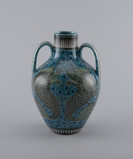 Two high handles rising from the shoulders. Blue Hispano-Moresque  decoration with dolphins.