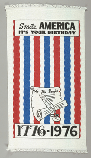 "Printed terry cloth towel. At top- ""Smile America, It's your Birthday"" and at bottom ""We the People"" on a scroll next to a quill pen in ink pot and ""1776-1976"". The central section red and blue stripes on the white fabric."