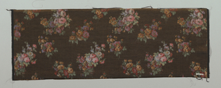 Heavyweight silk with horizontal ribbing has a multicolored design of small-scale sprays of roses and other flowers on a dark brown ground. Both selvedges present.