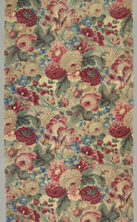 Dense, allover floral design with roses, tulips and other flowers in shades of red, green, blue and yellow on a white ground fabric.