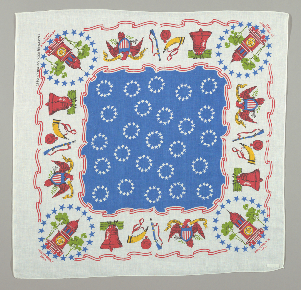 Scarf commemorating the U.S. Bicentennial. Outside border: In each corner Independence Hall with sides filled in with Liberty Bell, rifle and eagle. Fields: all over pattern of white stars on a blue background.