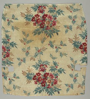 Glazed chintz with large bunches of naturalistic flowers and berries, block-printed  on roller-printed moire ground in two shades of pale tan; once white. Flowers in shades of rose, blue, green drab. Lined with plain cotton and bound with green ribbon - part of chair upholstery. Glazed.