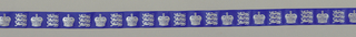 Commemorative ribbon designed for the Silver Jubilee of Elizabeth II of Great Britain. Closed crown alternates with three stacked lions. Printed in white on a blue ground.