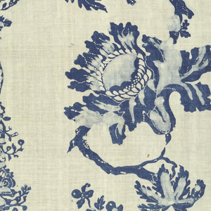 Panel of white cotton, loosely woven, printed in blue. Design shows vertical columns decorated with foliage that alternate with a meandering vine and flower design in a perpendicular arrangement. Printed in two shades of blue and has characteristic white dots found in other blue resists. Both selvages present.