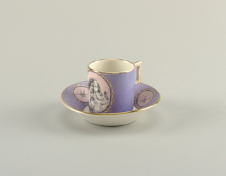 Light purple ground with circular reserves framed by painted chains. The ground within the reserves is pale pink and is painted in grisailles showing putti on cup and military trophies on saucer. The interior of the cup and bottom of the saucer are undecorated. Rectangular handle.