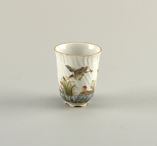 Beaker in the form first made in 1737 –1740 for the Swan Service. Painted decoration shows a bird in flight and a house on the shore.