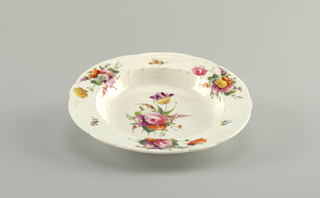 Molded with relief floral decoration and fainted with scattered flowers.