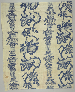 White ground resist printed in two shades of blue with a design of a large flowering vine between pillars.