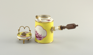 Cylindrical, spouted body with handle of porcelain and wood. Decorated with quatrefoil reserves containing landscape in purple, on a yellow ground. B) cover, flat, with landscape reserve, bronze handle and perforated center.
