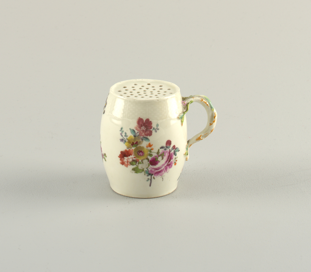 Barrel-shaped pot with molded basket-weave border. Perforated top. Handle modeled to resemble a twisting vine with flowers. Body decorated with floral bouquet.