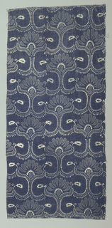 Textile with design of stylized floral scrolls, in white on a blue ground.