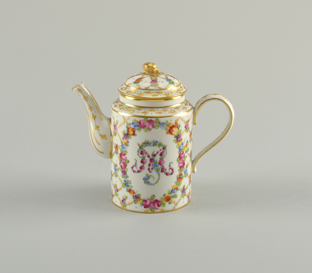 Cylindrical body and domed lid with gilded flower finial. Diaper pattern with flowers at crossings. Gilded spout and handle. Floral monogram.