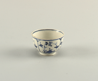 "Curved, without handle. Reeded on inside and blue underglaze decoration showing ""strohblumen"" pattern."