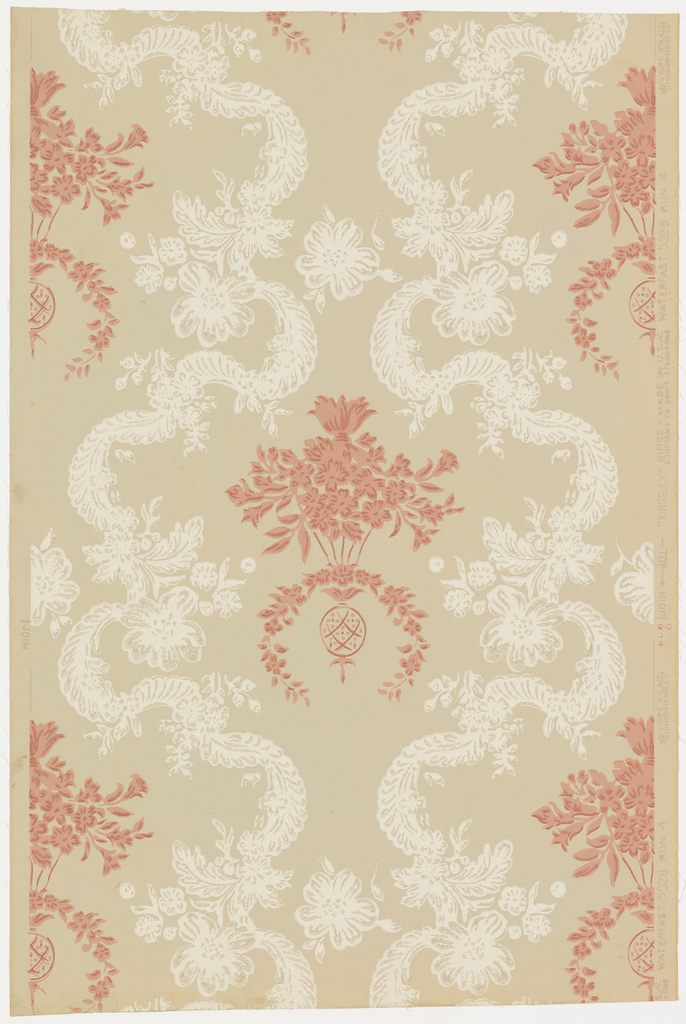 """Inspired by French 18th century, Louis XV period. Simulates textile design of festooned bands of lace, caught with floral bouquets forming medallions which contain a bouquet of flowers suspended from a spray of leaves. This design was reproduced from paper found in old colonial house near Philadelphia, Pennsylvania. Printed on reverse side: """"No. 250 CB, French Damask"""". Printed in rose ivory and tan on putty field."""