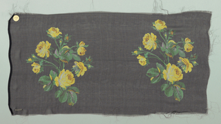 Sample with a black ground with repeating rows of a life-size spray of roses in shades of yellow and violet.