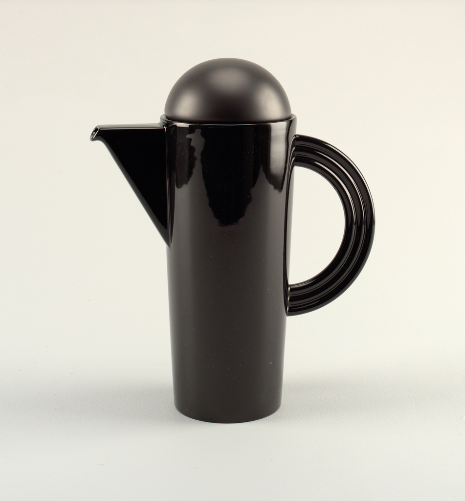 Tall black coffee pot with angular spout, bowl-like round lid, and C-shaped handle made of three tubes.