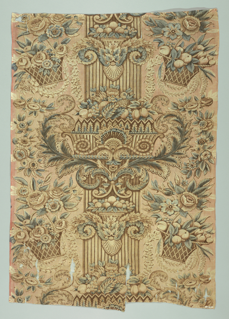 Pillar print of brown and blue with fluted columns, scrolling capitals and baskets of fruits and flowers.