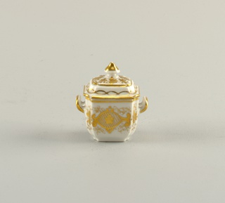 Sugar bowl and lid, belonging to a tiny porcelain tea set with gold detail.