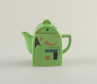 Green abstracted geometric teapot and cover with blue and orange abstract painted accents.