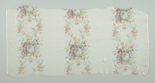 Textile sample with an off-white ground has three broad vertical columns of densely massed small roses and other flowers. Both selvedges present on all samples.