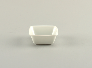 Square form with deep walls angled out, rounded lip at top; white glaze.