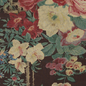 Large bouquet of roses with smaller climbing rose brances and other flowers. Background of dark brown and floral pattern in shades of red, green, blue and white.