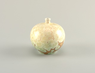 Thrown, porcelain spherical body with crystalline glaze shading from ivory to light green, on background shading from a light to dark beige color.  Semi-glossy finish.